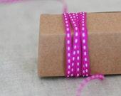 25 yard roll of Fuchsia with White center stitch grosgrain ribbon