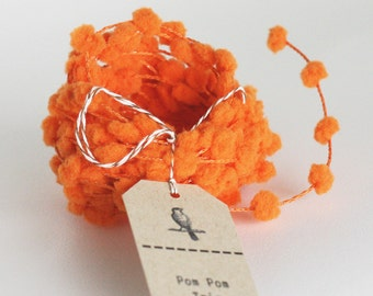 Wholesale 25 yard roll of Orange wired pom pom garland trim