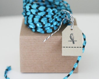 Deep Discount Clearance! 50 yard roll of Turquoise and Black Balloon Satin Cording Ribbon