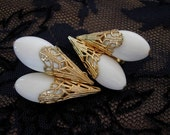 Napier Filigree and White Plastic Tear Drop Clip Earrings