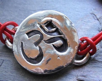 Sterling Silver Om Ohm Sign Bracelet on Red Leather