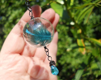 Magical Floating Feather Bubble on gunmetal chain with aqua drop