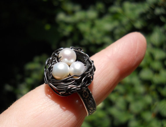 White Pearl  Magic  birdnest ring on silver floral adjustable band