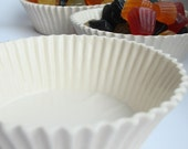 Two ceramic cup cake style dishes