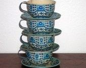 Wolverine teacup set of four