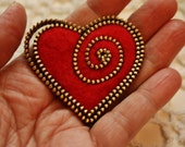 Heart brooch kit.... brass zipper and two ready cut hearts... no instructions included in this purchase, supplies only.