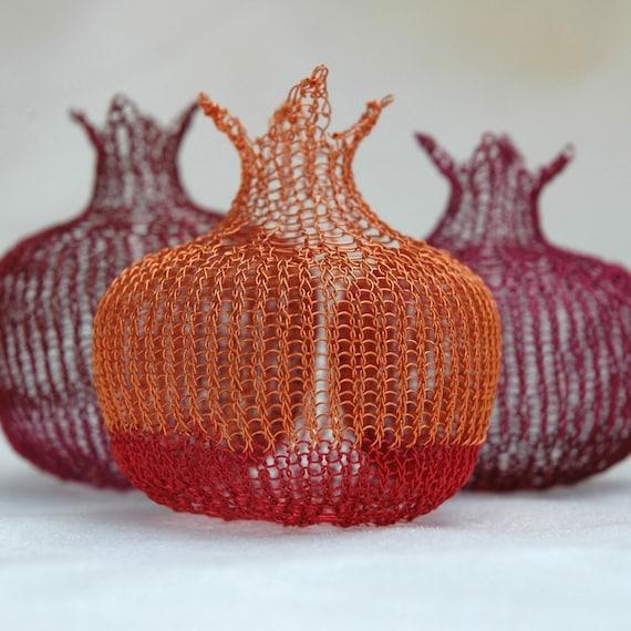 small pomegranate in delicious orange