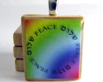 Circle of Peace - Shalom - Hebrew Scrabble tile pendant on rainbow background