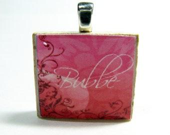 Bubbe - Grandma or Grandmother - Hebrew Scrabble tile pendant with pink flourish design