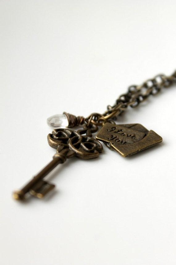Charm Necklace, Skeleton Key, Love Letter,  Brass Necklace, Wirewrapped Crystal