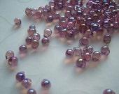 10 grams of Japanese Fringe Beads - Transparent Rainbow Lavender Color
