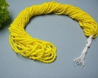 One hank of Czech Opaque Light Yellow seed beads - 0303 size 11