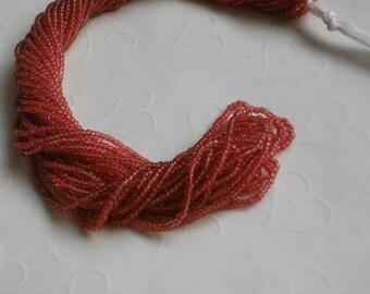 One hank of Czech Sol Gel Transparent Cranberry seed beads - 0207 size 11