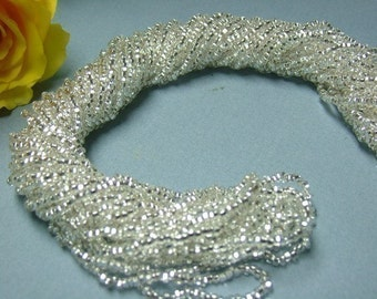 One hank of Czech Square Hole Silver Lined Clear seed beads - 1201 size 11