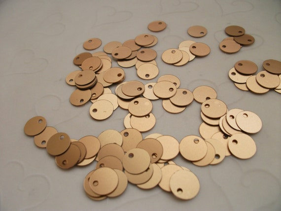 7g of 8mm Side Hole Flat Round Sequins in Matte Gold Color