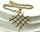Big Pendant Necklace. Metal Charm Necklace. Geometry. Crossing Lines. Antiqued Brass. Zig Zag.