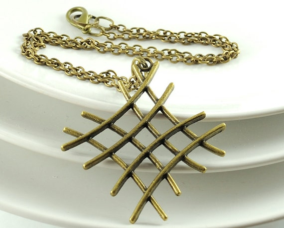 Big Pendant Necklace. Long Necklace. Metal Charm Necklace. 24 inches. Geometry. Crossing Lines. Antiqued Brass. Zig Zag.