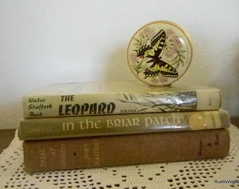 Three Vintage Books in Warm Tones, and a Tin