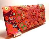 "Wallet.  Orange, green, purple, pink, periwinkle.   Fabric:  Kaffe Fassett Millefiore Tomato.  ""World's Greatest Wallet"" by relaine."