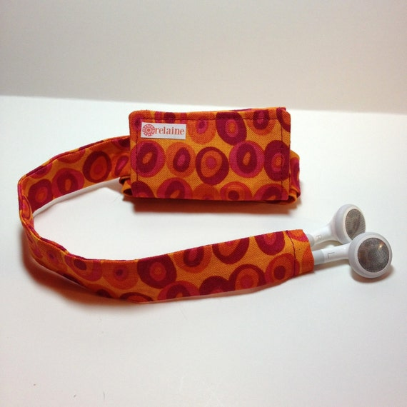 TuneTube.  iPhone/iPod headphone/ear bud cord organizer.  Orange and pink circles.