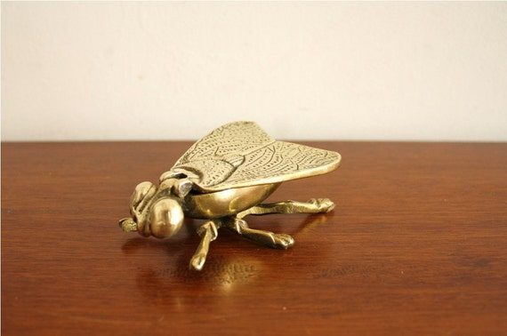 Vintage brass fly with flip up wings, England