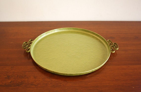 Olive green round serving tray with Asian handles and brass accents