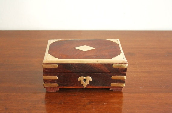Vintage wooden box with brass inlay