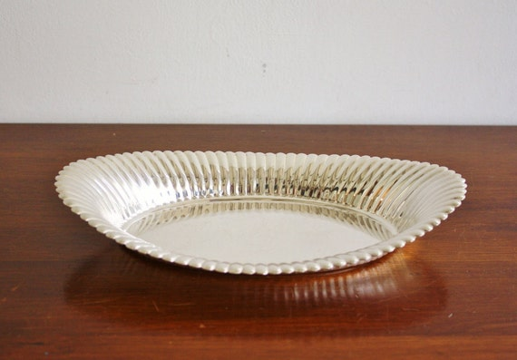 Vintage silver dish with scalloped edge