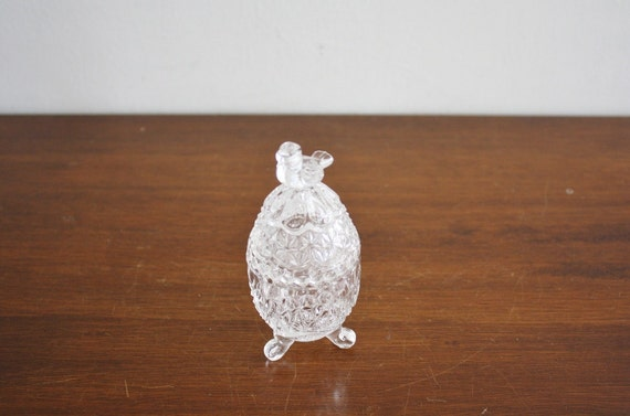 Vintage crystal oval box with perched bird on lid