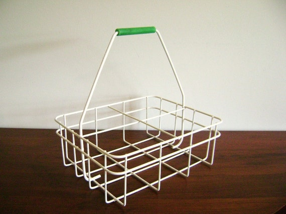 Vintage white milk crate wire grid with a green handle