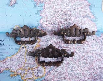 SALE! 3 vintage curvy brass metal handles with center keyholes*