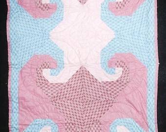 Pink spiral quilt