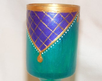 Iridescent green, purple and gold candle holder.
