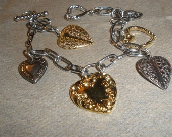 sale, Wonderful Vintage Silverplate, goldplate, better grade heart charm bracelet, heart toggle clasp, more hearts can be added...