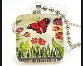 Butterfly in garden. Glass pendant with ballchain necklace