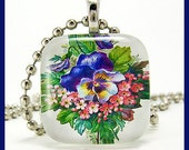 Pansy flowers.  Glass pendant with ballchain necklace