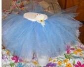 light blue tutu with white flower