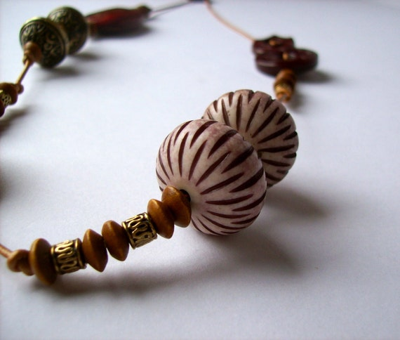 Eclectic necklace.Vintage lucite urchins. Vintage buttons.Coconut shell,bone and lucite rondelles.