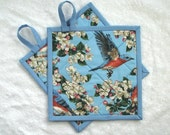2 potholders, bluebirds and apple blossoms