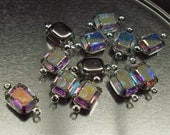 Destash 6 pieces of swarovski glass crystal ab 10x8mm octagons preset in 2 ring silver settings