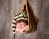 Tassles and stripes.  Great newborn photograph prop.  Hand knit.