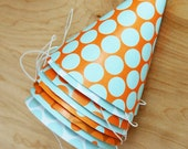 party hats. light blue and orange polka dots. set of 8