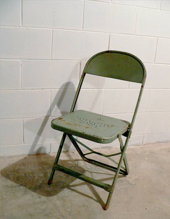 Vintage metal folding chair with star on seat
