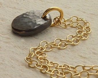 Eco friendly necklace, Oxidized silver pendant with a gold necklace,  Black Organic pendant hung from gold chain