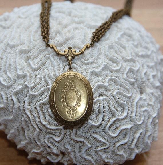 Antique brass locket victorian ornate