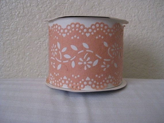 One 12 yard by 3 inch wide roll of soft pale peach paper eyelet lace ribbon