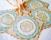 Seashell Tags hand stamped seashells soft blue khaki sand sepia brown raffia ties