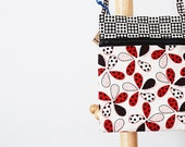 Over the shoulder hipster pouch in red, black, and white flowers and polka dots