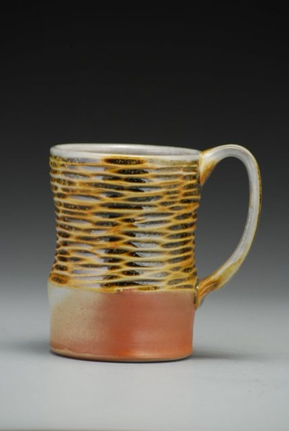 Ripple Mug with amber glaze, hand carved texture, wood and soda fired, porcelain
