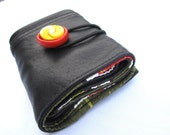 Black leather wallet with red and yellow button